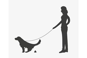 Silhouette of woman walking a dog om leash.