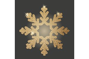 Gold snowflake on dark background.