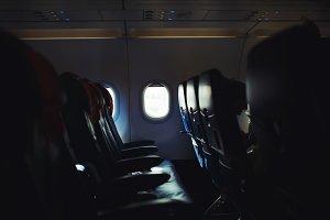 Plane interior, empty seats, windows