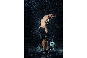 Water drops around football player