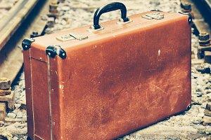 Vintage suitcase on railway