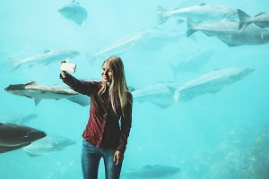 Woman taking selfie by smartphone