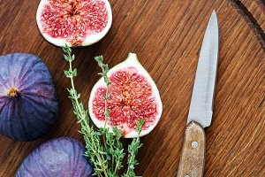 Fresh purple figs on wooden cutting board