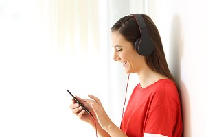 Girl listening to music on line