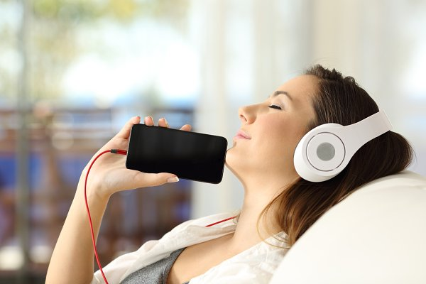 Girl resting listening to music