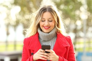 Portrait of a woman using phone