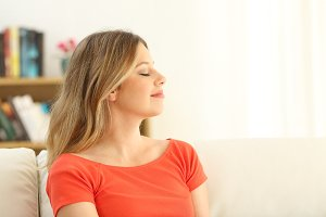 woman relaxing with closed eyes