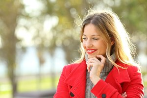pensive lady wearing a red jacket