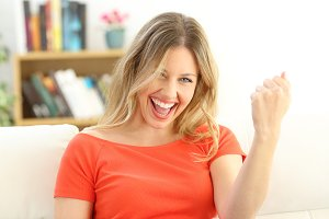 Portrait of excited successful woman