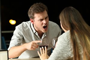 Angry couple arguing furiously