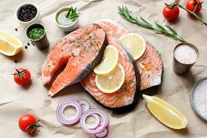 Salmon steaks with herbs, spices and lemon ready for cooking
