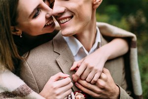 Happy, smiling couple is tenderly hugging. Close-up portraits. Wedding. Artwork
