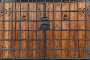 wooden texture of old doors with forging elements