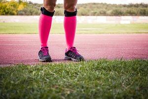 female legs wearing sport equipment