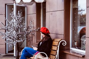 brunette woman in red beret