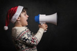 boy with a megaphone at christmas