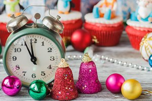 Old alarm clock near Christmas colored decorations