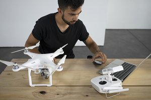 Man works with drone and gadgets