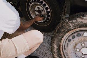 Man fixes wheel
