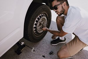 Man fixes wheel