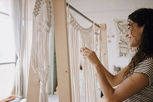 Woman creates macrame
