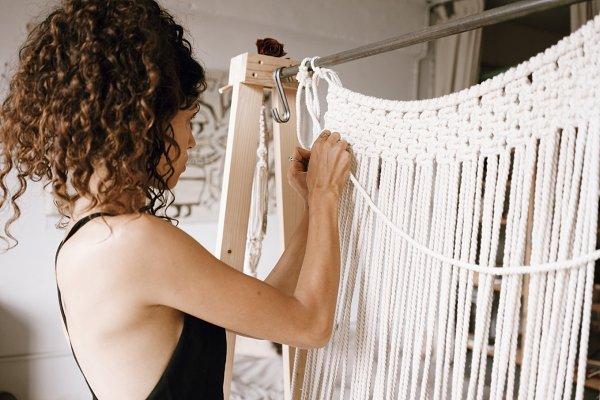 Arts & Entertainment Stock Photos: Julia Brenner - Woman creates macrame