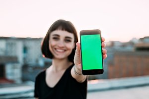 Young woman smiles with phone