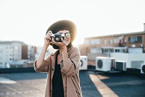 Hipster female and analog camera