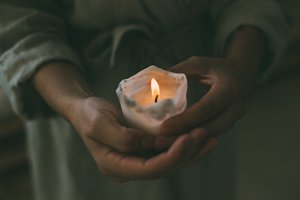 Woman holds candle