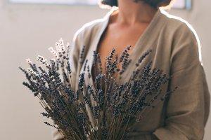 Artisan sensual woman holds lavender