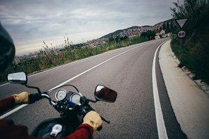 POV motorcycle handlebar on road