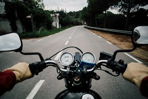 POV motorcycle handlebar on road