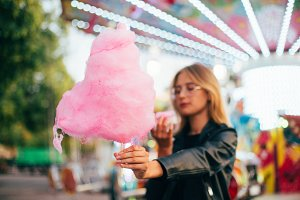 Young hipster woman eat cotton candy