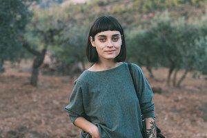 Girl enjoys nature in olive garden