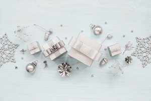 Silver gift boxes and snowflakes