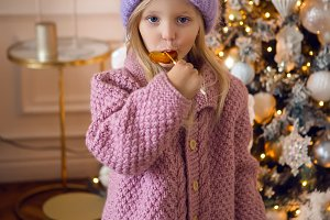 girl in the sweater and the hat is from candy in the new year