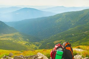 Two backpacks in the mountains