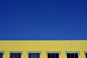 Blue sky and yellow wall