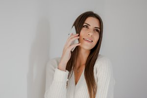 Pretty young woman using phone