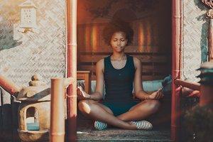Black girl meditating, aura on head