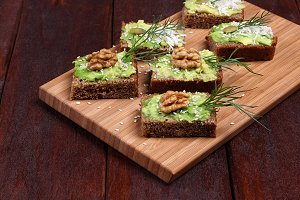 Canapes with paste of avocado