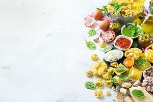 Italian food and ingredients, ravioli pasta spaghetti pesto tomato sauce