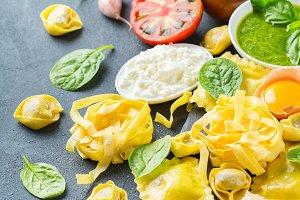 Italian food and ingredients, ravioli pasta tortellini pesto tomato sauce