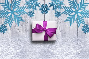 Snowflakes, gift bow and real snow