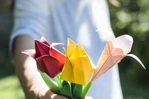 Woman hold bouquet of origami flower