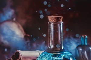 Marine scene with a tornado sealed in a laboratory flask, compass, seashells and water drops.
