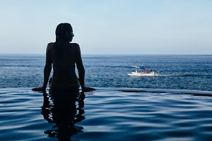 Girl at infinity pool