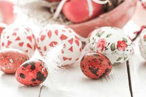 Easter eggs on a light wood background,