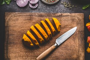 Sliced pumpkin on cutting board