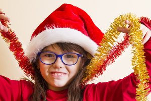 girl playing with christmas ribbon